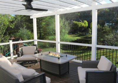pergola canopy rafters white second story balcony pond dining room fan