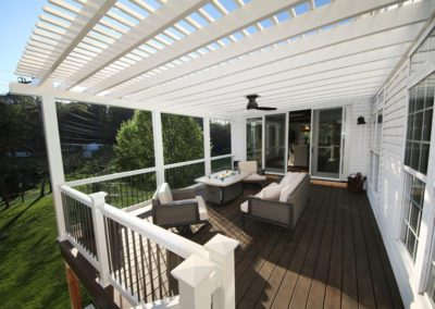 pergola canopy rafters white second story balcony pond dining room