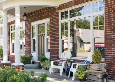 classic front porch entrance round windows pella