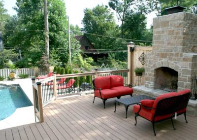 brick outdoor fireplace pool porch wood