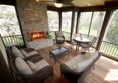 four seasons room retractable shades fireplace back porch patio deck